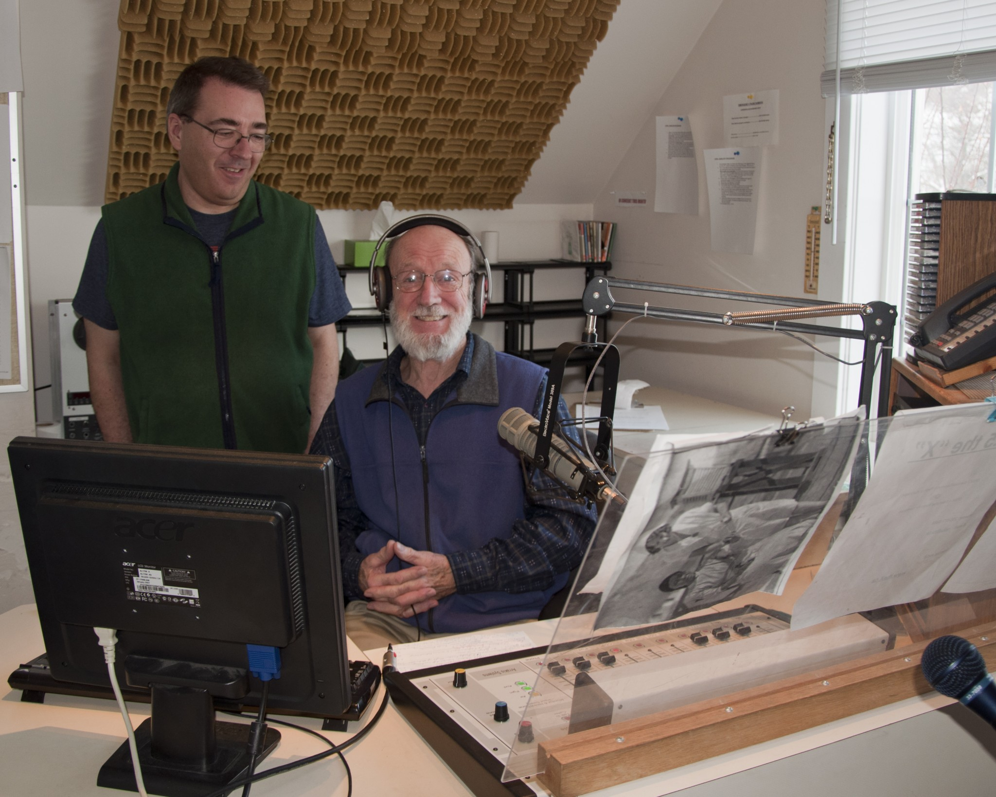 Steve Marlow, programming director, works in-studio with volunteer Jack Jones.