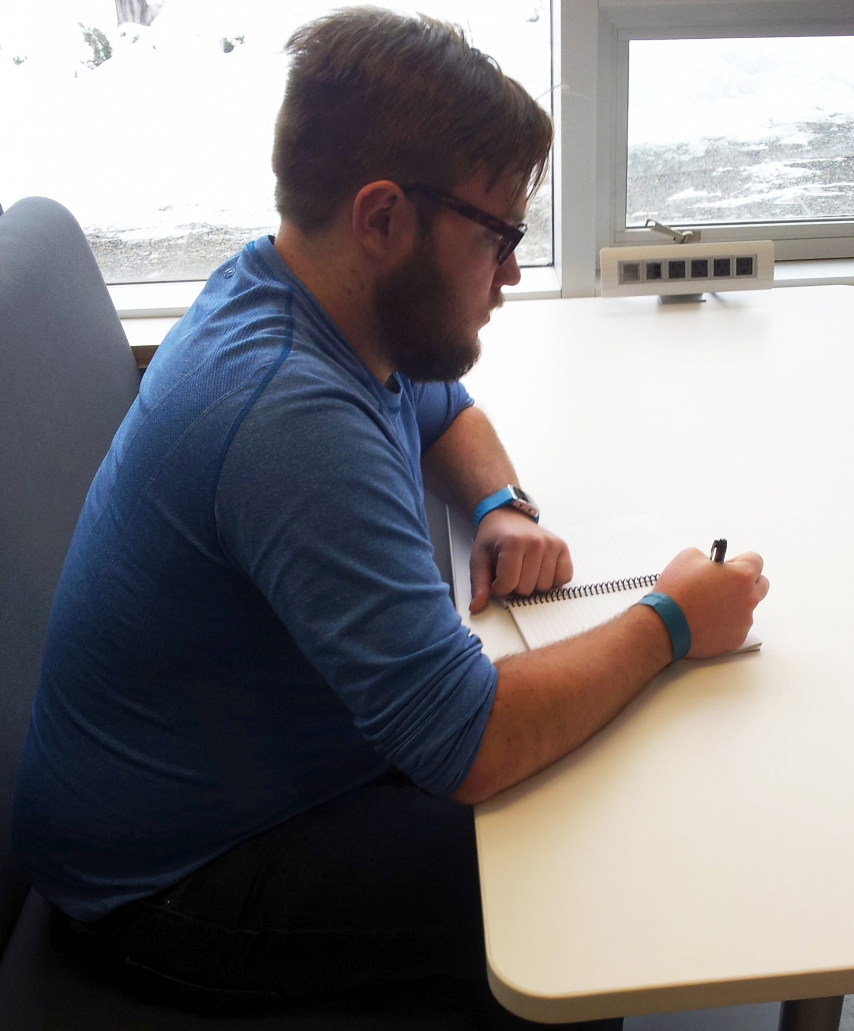 TRUSU president Dustin McIntyre studys in the new one of the new study carrels. - Photo by Devan C. Tasa