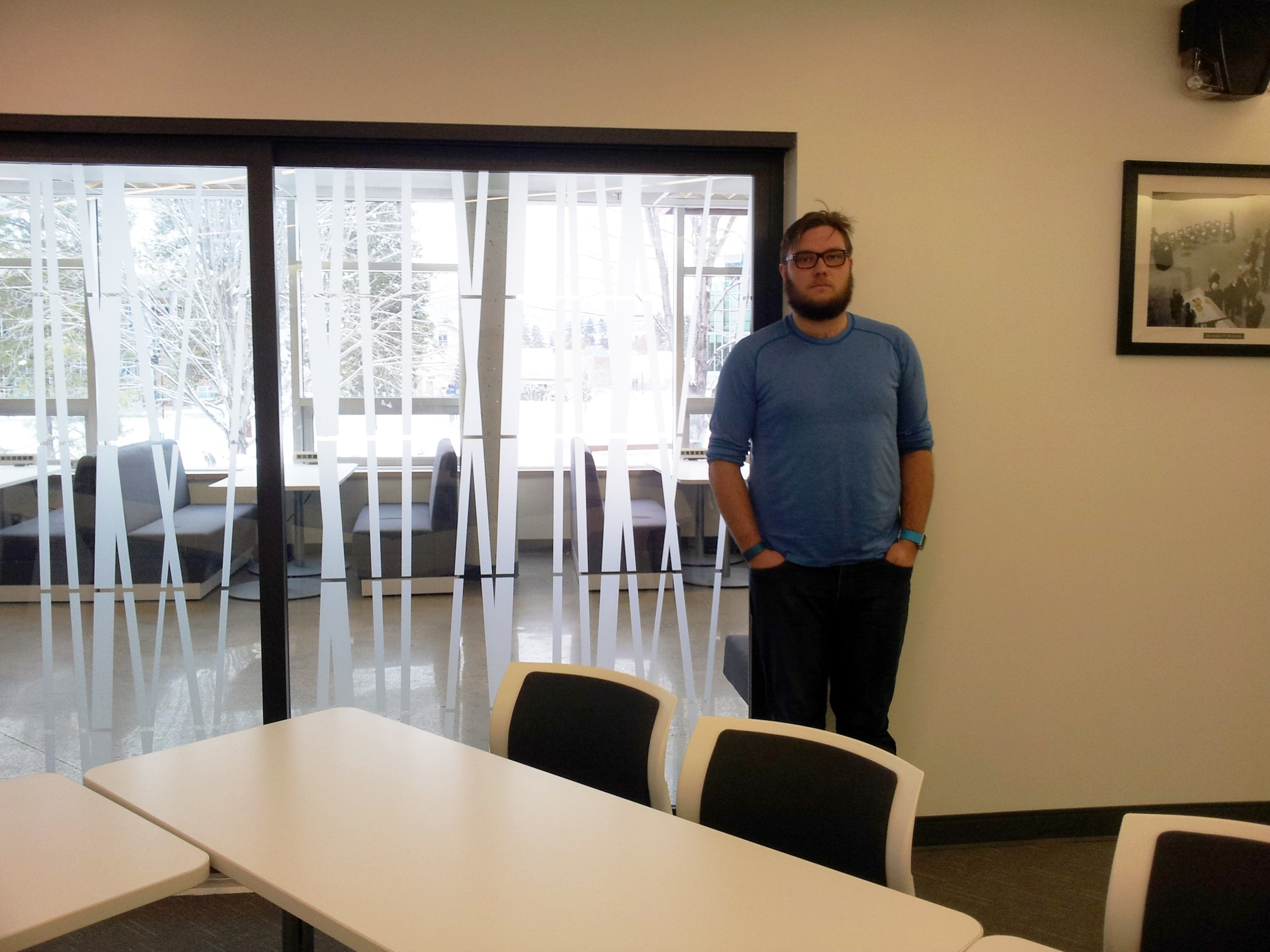 TRUSU president Dustin McIntyre stands in the new TRUSU Boardroom. - Photo by Devan C. Tasa