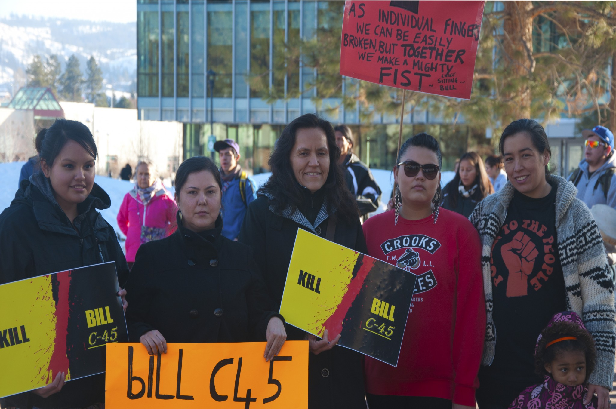 Jolene Michel, Nicole Kahoose, Rhoda Tom, Shania West, Michelle Ikwumonu and daughter pose at the Idle No More demonstration on TRU campus. - Photo by Wayne Cardinal