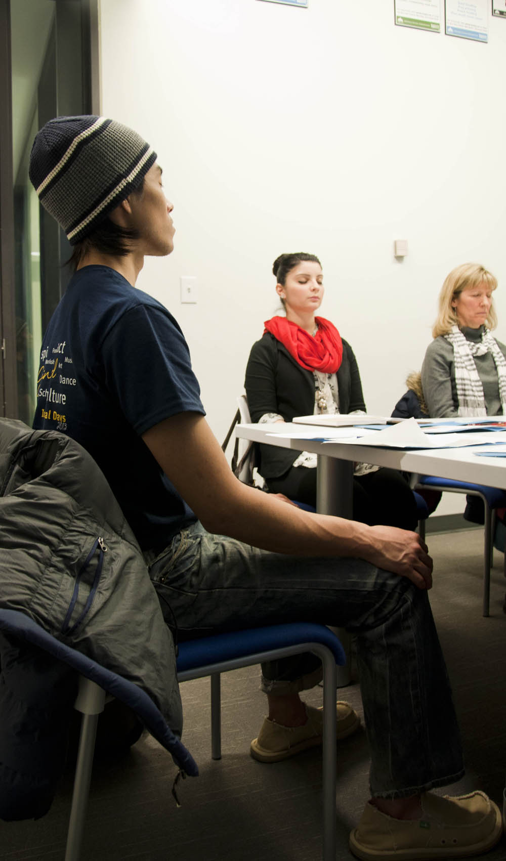 Kai Liang, adventure tourism student finds peace during a meditation exercise at the Tree of Life Cognitive Behavioural Therapy Workshop on Feb. 12. - Photo by Courtney Dickson