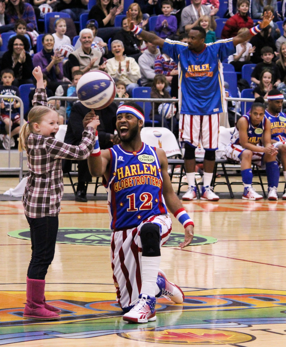 The Harlem Globetrotters brought their usual mix of fun and games to the TCC on February 13th. One lucky audience member got to try her hand at one of the Globetrotter's signature tricks. - Photo by Kevin Skrepnek