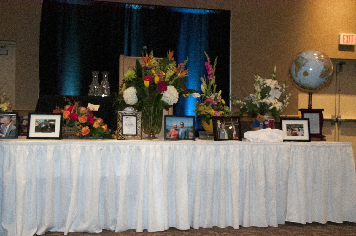 In front of the podium at Wes Koczka's memorial in the Grand Hall on March 15 were pictures and flowers celebrating his life. - PHOTO BY DEVAN C. TASA