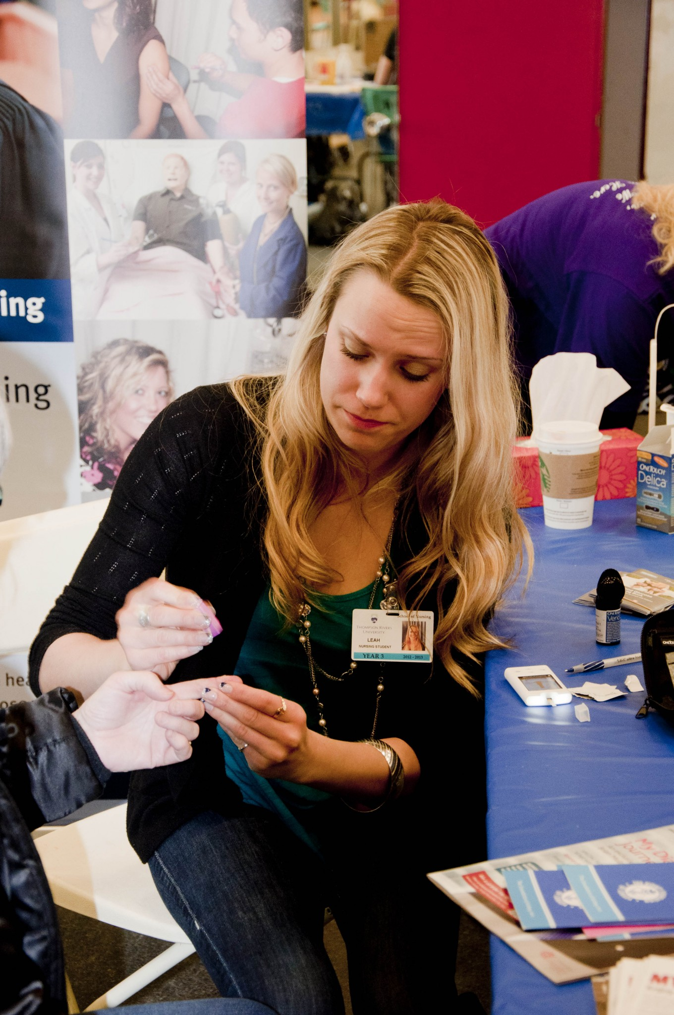 Third-year nursing student Leah Tigchelaar checked blood glucose levels of patients at Sahali Mall on World Kidney Day.- PHOTO BY COURTNEY DICKSON