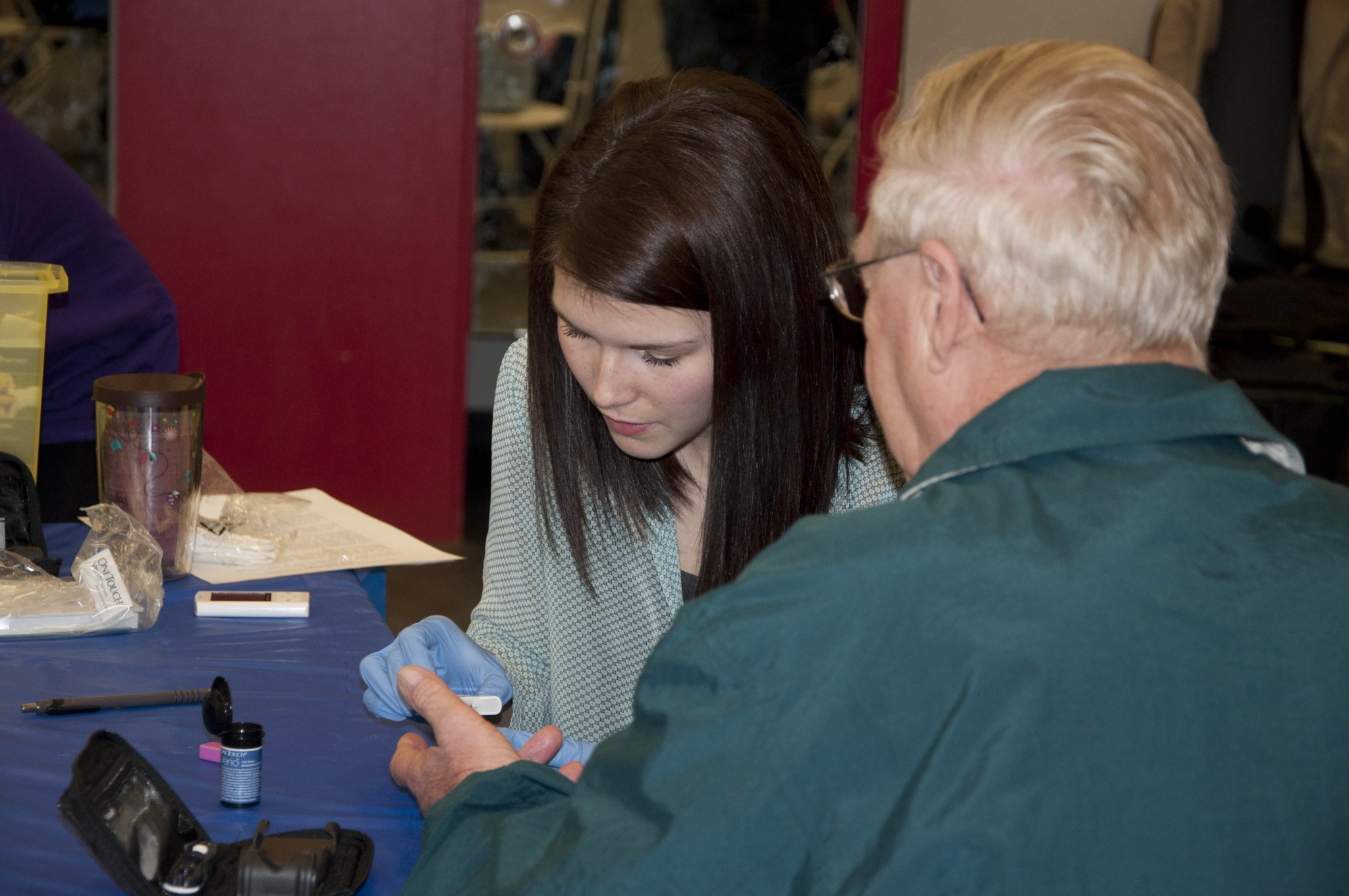 Nursing student Chelsea Brown volunteered to educate patients and assess blood glucose levels at World Kidney Day on March 14. - PHOTO BY COURTNEY DICKSON