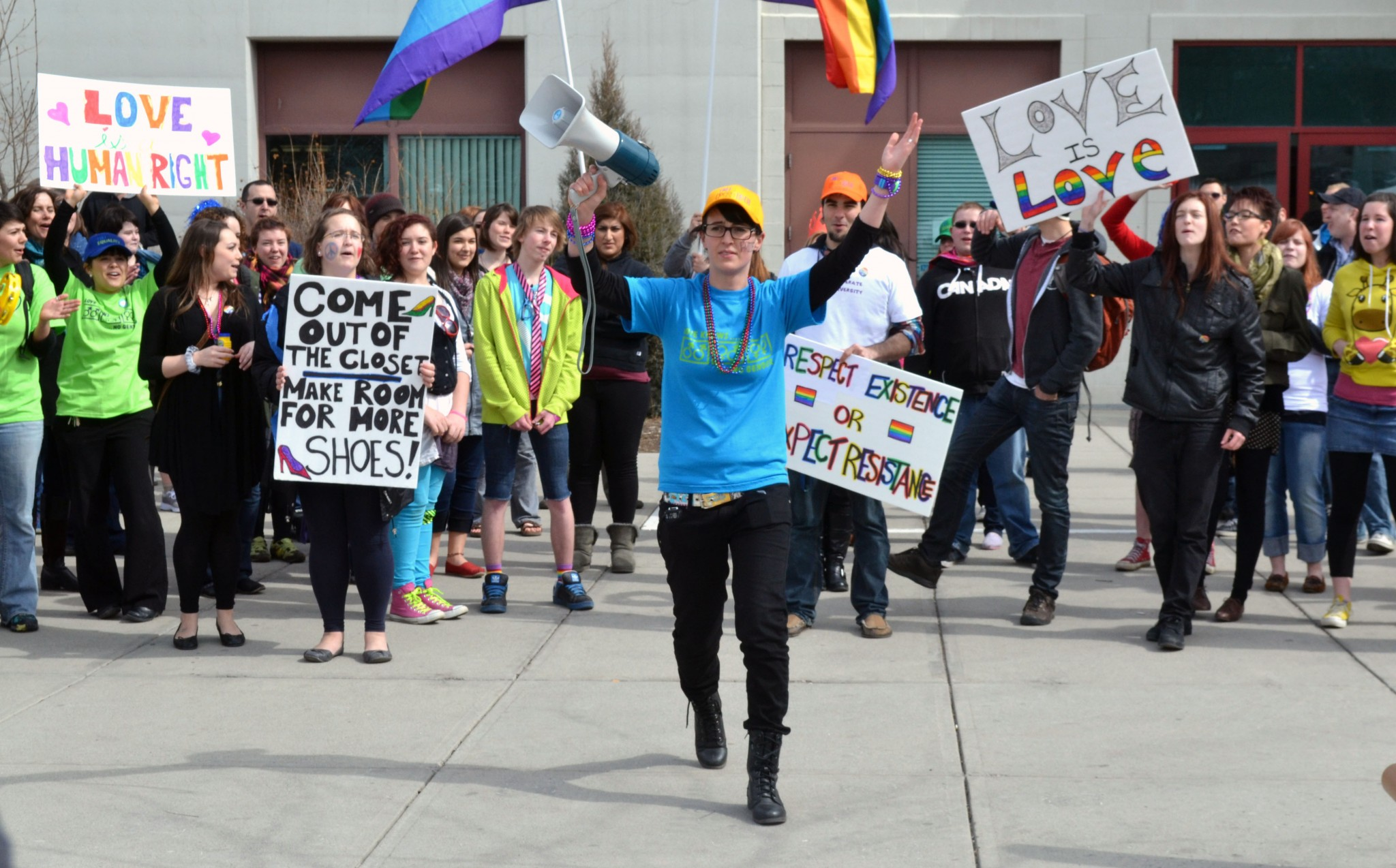Katelyn Echlin-Scorer (centre in blue shirt), one of the organizers of the first pride parade last year, leads that march across campus. - PHOTO BY SAMANTHA GARVEY