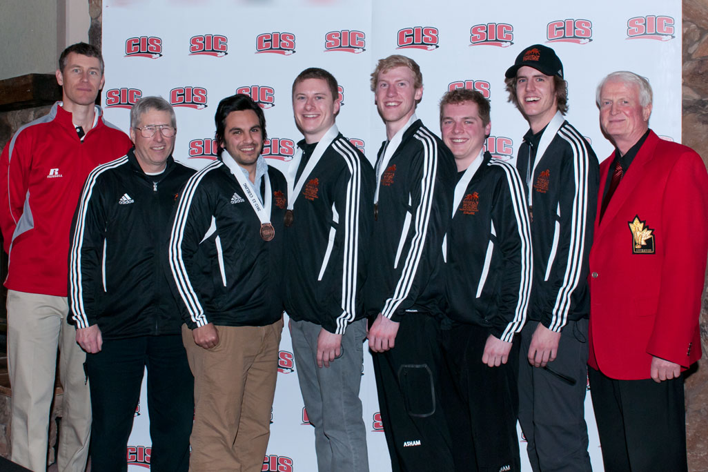 James Keough (CIS representative), coach Ray Olson, David Gore, Michael Hiram, Jared Jenkins, Russ Koffski, Darren Nelson and Jim Mann (CCA representative) pose with Bronze medals following Saturday's semi-finals loss to Waterloo. - PHOTO BY GEORGE WYCHERLEY PHOTOGRAPHY