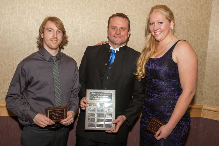 TRU Sports Task Force athlete of the year award winner Kevin Pribilisky, presenter vice president advancement Christopher Seguin and award winner Diane Schuetze. - PHOTO BY ANDREW SNUCINS