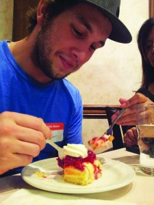 Parker Smith enjoys the Raspberry Flan at Swiss Pastries Bakery and Café to end the night.