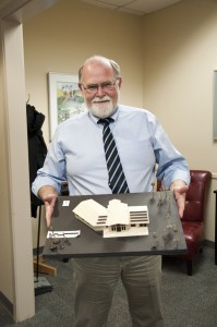 Tom Dickinson proudly holds Blake St. Peter's design for a new building. Karla Karcioglu/The Omega