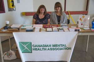 Shirley Sidney (right) and CMHA activity coordinator with Lauren White (left), tend at their booth in Old Main. Karla Karcioglu/The Omega