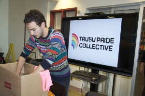 TRUSU pride collective representative Nic Zdunich collects goods and inspiring messages on Oct. 17 for Russian LGBTQ refugees seeking asylum in Vancouver in Old Main. Jessica Klymchuk/The Omega