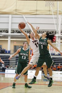 Taiysa Worsfold muscles her way by Desarae Hogberg (1) in the WolfPack's 76-54 loss to the UofS Huskies on Saturday. Worsfold led the 'Pack  with 28 points and seven rebounds. Image courtesy Andrew Snucins