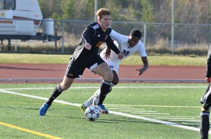 TRU WolfPack striker Jacob Kaay (15) fights off a MSVU Mystics defender during a Wednesday match at the CCAA men's soccer national championship in Saint John, N.B. Photo courtesy TRU Athletics