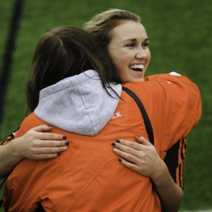 The WolfPack's Katie Sparrow hugs her mom following TRU's bronze medal victory. (Photo by Andrew Snucins)