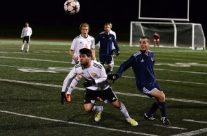 Oriol Torres, who was named a tournament all-star, heads the ball in the gold medal match against Humber College. Photo Andrew Snucins