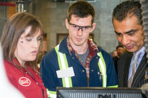 Apprentices Jamie Gainsforth and Eric Moore show B.C. Advanced Education Minister Amrik Virk how a technologically advanced engine operates. Jessica Klymchuk/The Omega