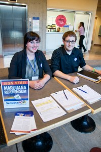 Madi Lowe and Mike Neigel have collected around 75 signatures for the marijuana referendum petition on campus. Jessica Klymchuk/The Omega