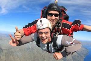 Nick Byers takes his friend on her first jump over Queenstown, New Zealand in the spring of 2012. Photo by Erika Dufort