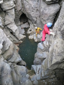 Cavers climbing down to explore the underground river. Image courtesy Nicholaus Vieira
