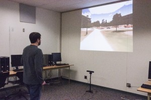 Alex Touchet uses a Kinect to navigate the virtual campus. Mark Hendricks/The Omega