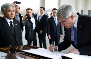 Hey, look, it's Stephen Harper signing something. He's probably allowed to, right?