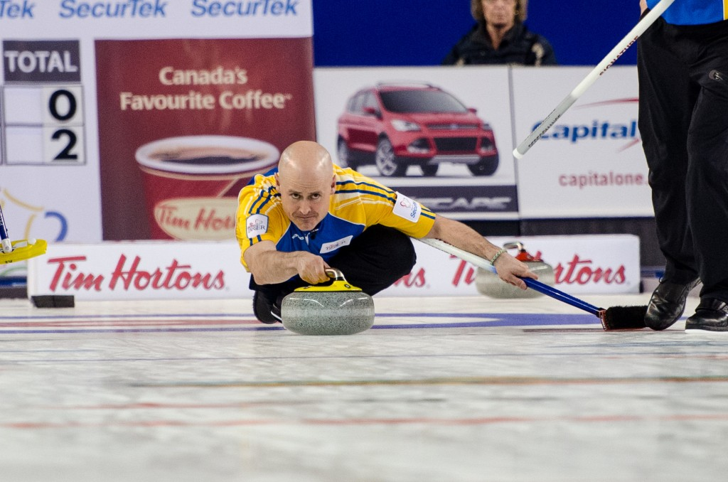 Skip Kevin Koe led the Alberta rink to victory in Saturday night's semifinal game, with an 11-end 9-8 win over Quebec. Sean Brady/The Omega