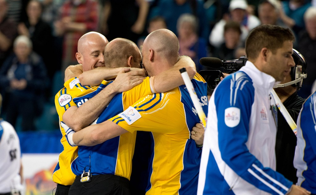 An elated and exhausted Team Alberta celebrates their 2014 Brier Championship title.  Mike Davies/The Omega