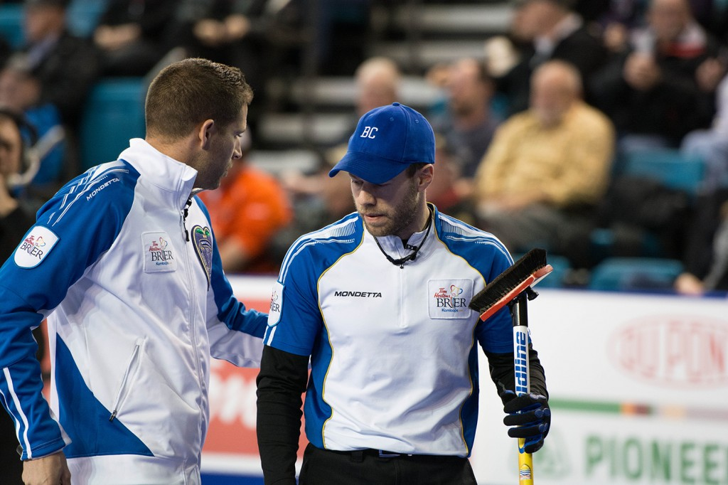 Skip John Morris congratulates Jim Cotter after Cotter clears the house of all of Alberta's stones at the end of the third end, forcing Kevin Koe of Alberta to draw for a single against three B.C. stones. Mike Davies/The Omega