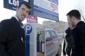 Kappa Sigma member Will George pays for a student's parking on Feb. 26 for RAKnomination (random act of kindness) to counteract the dangerous online drinking game neknomination. Jessica Klymchuk/The Omega