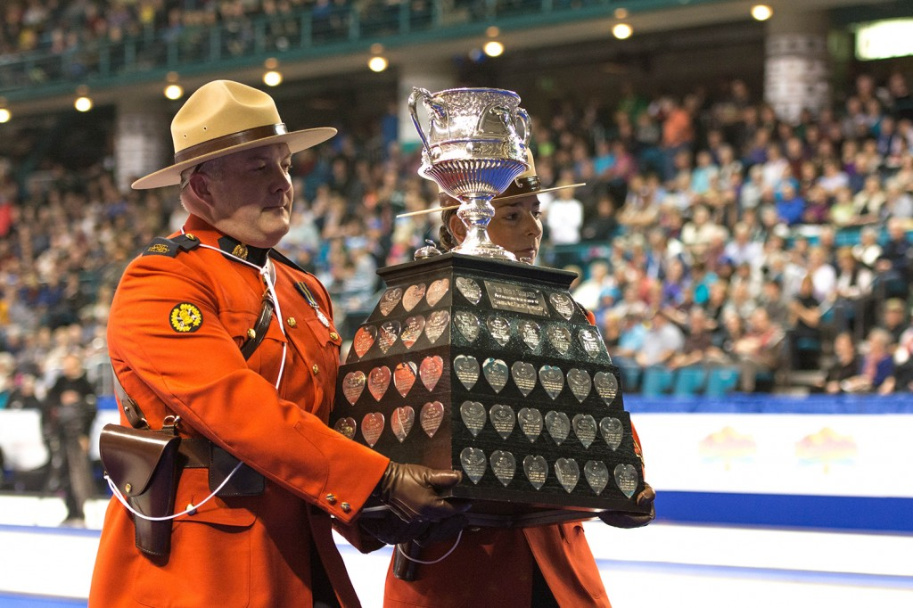 The Brier Tankard, the trophy presented to the winning team at each championship tournament is delivered in traditional fashion to the ice surface during the seventh end break.    Mike Davies/The Omega