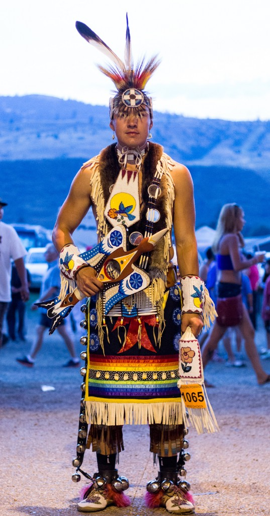 Ryan Oliverius stands dressed in his regalia, with beadwork inspired by his own Okanagan band. (Sean Brady/The Omega)