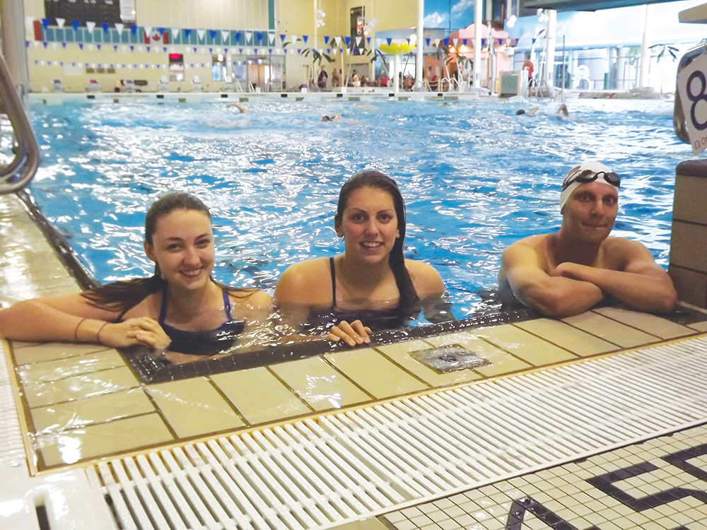 WolfPack swimmers (from left to right): Jacquelyn Belanger, Sarah McChesney and Jagdeesh Uppal before a practice. (Tayla Scott/The Omega)
