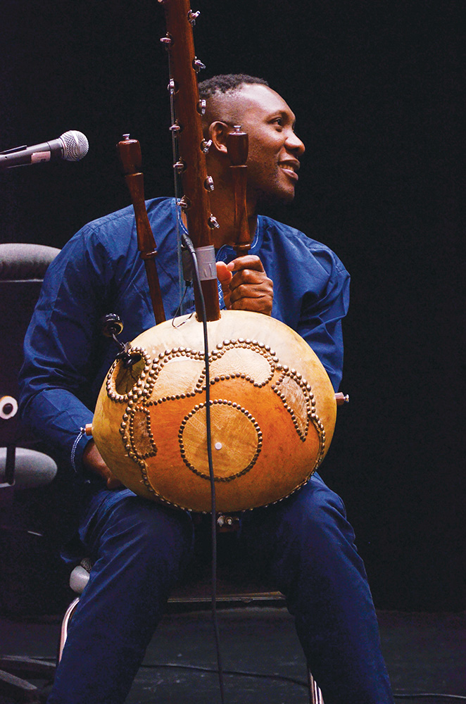 Bojou Cissoko playing the kora, a traditional West African instrument. (Kim Anderson/The Omega)