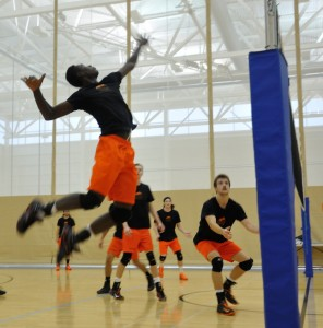 Charles Oduro, rising here to spike the ball during a WolfPack practice, is one of the six that joined the 'Pack from Team BC. (Tayla Scott/The Omega)