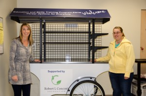 Leanne Mihalicz (left) and Autumn Greenaway (right) proudly show off the kiosk cart that was purchased through a Robert L. Conconi Foundation grant. (Carmen Ruiz/Contributed)