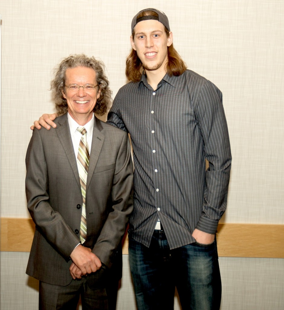 Kelly Olynyk and TRU president Alan Shaver pose for a photo during Olynyk's visit to the university. (Thompson Rivers University)