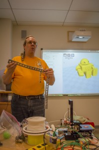 Dave Hylands shows a plastic chain he 3D-printed for one of his machines. (Ryan Turcot/ The Omega)
