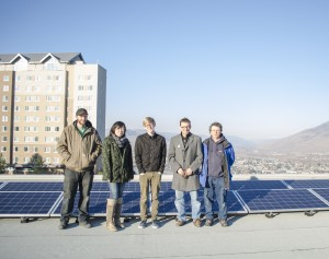 Left to right: Installer Greg Lambertus, TRU energy specialist Natalie Yao, TRUSU president Dylan Robinson, TRU environment and sustainability director Jim Gudjonson and engineer Ben Giudici stand on the CAC rooftop to observe the newly-installed solar voltaic panels. (Ryan Turcot/ The Omega)