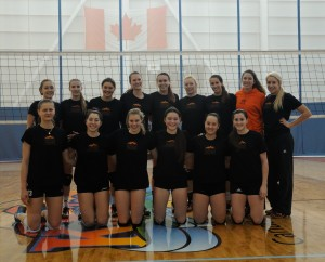 WolfPack women's volleyball team pose after a practice. (Tayla Scott/ The Omega)