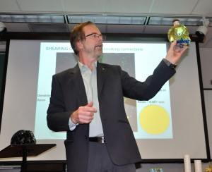 TRU researcher Jeff Dunn uses a glass skull to explain brain injury caused by a concussion. (Tayla Scott/The Omega)
