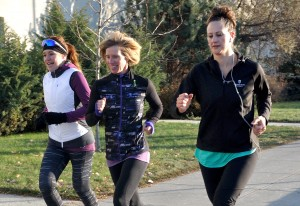Clara Hughes, Cindy James and Chelsea Corsi run the one kilometre lap around campus. (Tayla Scott/ The Omega)