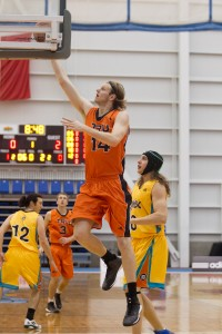 Josh Wolfram jumps to score on UNBC Timberwolves during the 'Pack's opening weekend (TRU Athletics)