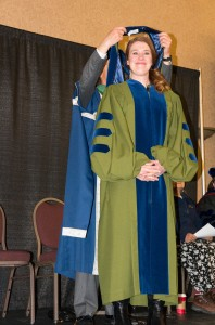 Making it official. Clara Hughes accepts her doctoral hood from TRU president Alan Shaver. (Alexis Stockford/ The Omega)