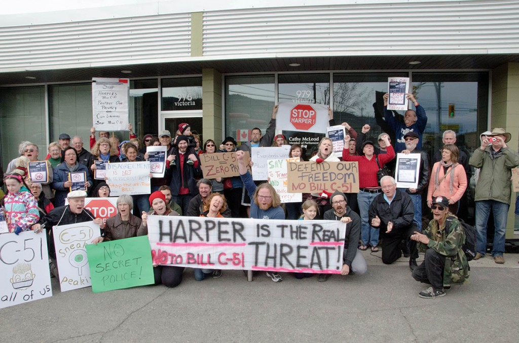 The group of protesters gathered outside of MP Cathy McLeod's office on March 14, 2015. (Jim Elliot/The Omega)