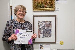 Wendy Patrick poses with her first place 2D submission, a close-up drawing of the Great Wall.  (Kim Anderson/ The Omega)