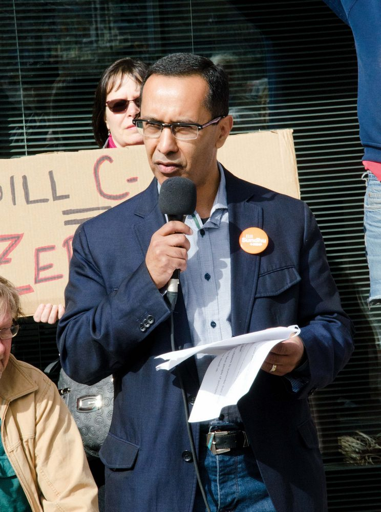 Federal NDP candidate Bill Sundhu addresses the crowd during the March 14 protest. (Jim Elliot/The Omega)