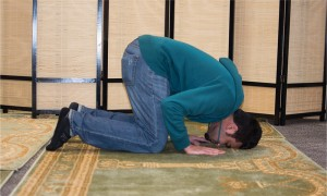 M. Daniyal bows his head in prayer in the north side of the new multi-faith space. (Ashley Wadhwani/The Omega)