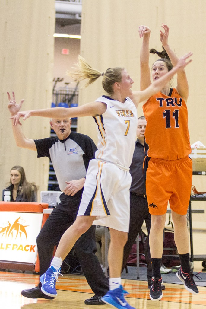Team captain Taiysa Worsfold shoots for three during Game 2. (Sean Brady/The Omega)