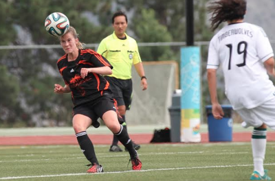 Emily Oliver heads the ball in a game against the UNBC Timberwolves. (TRU Athletics)